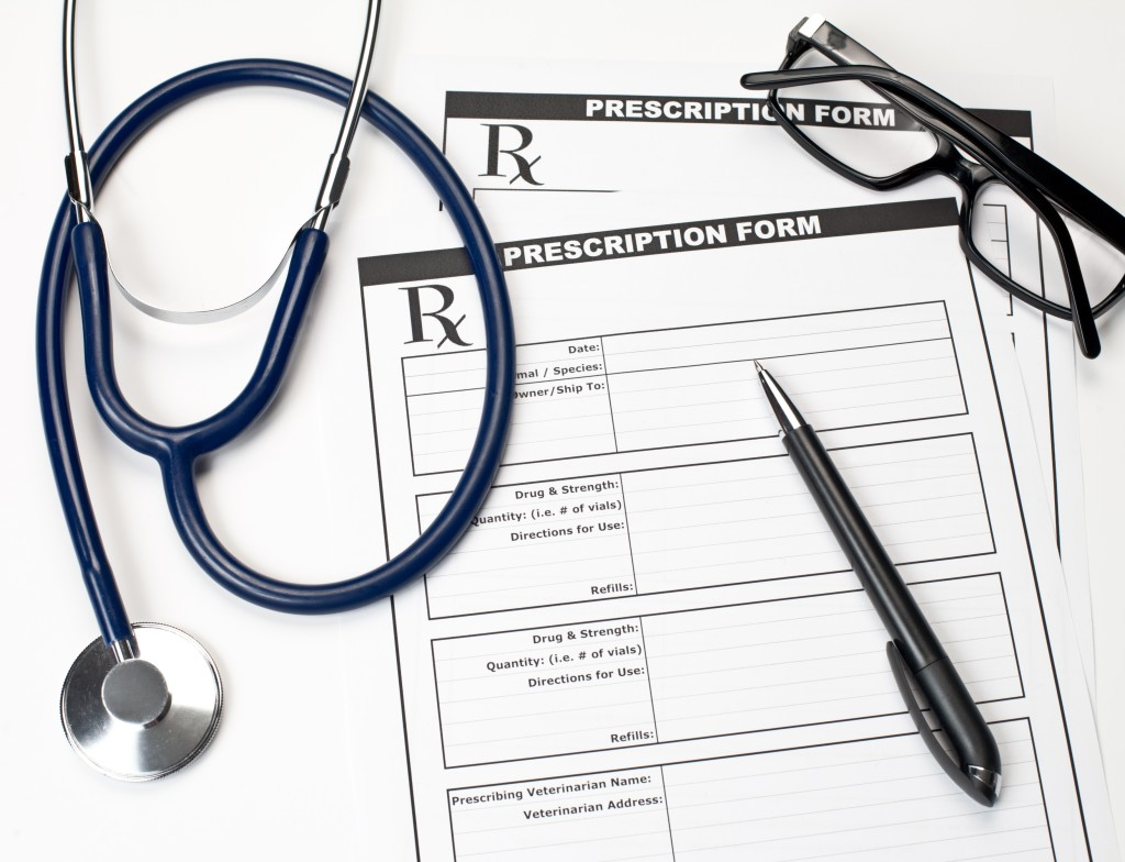 Blank veterinarian prescription form with stethoscope glasses and pen