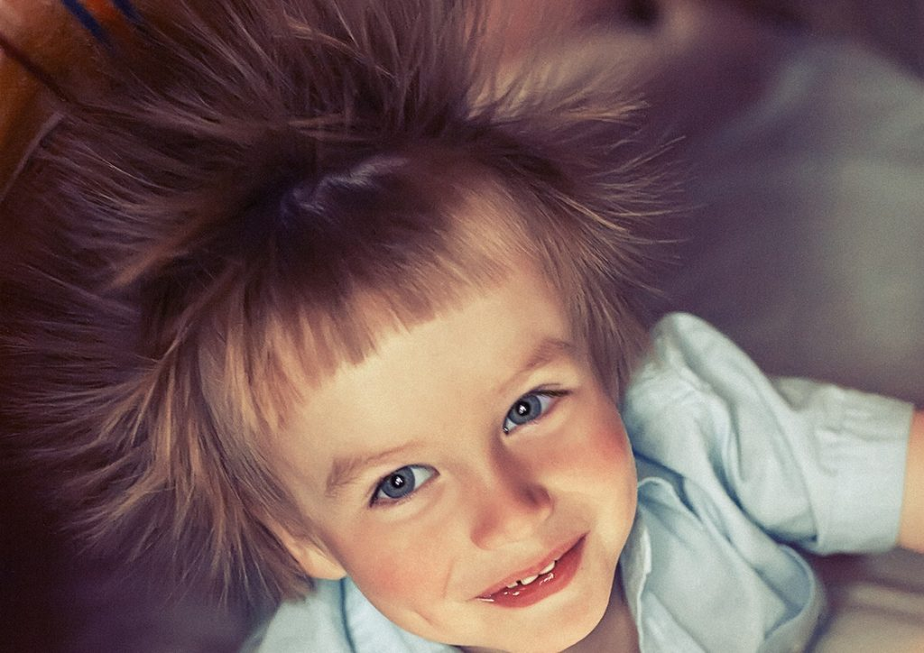 Little boy with electrified hair under bluncket. Grain added.