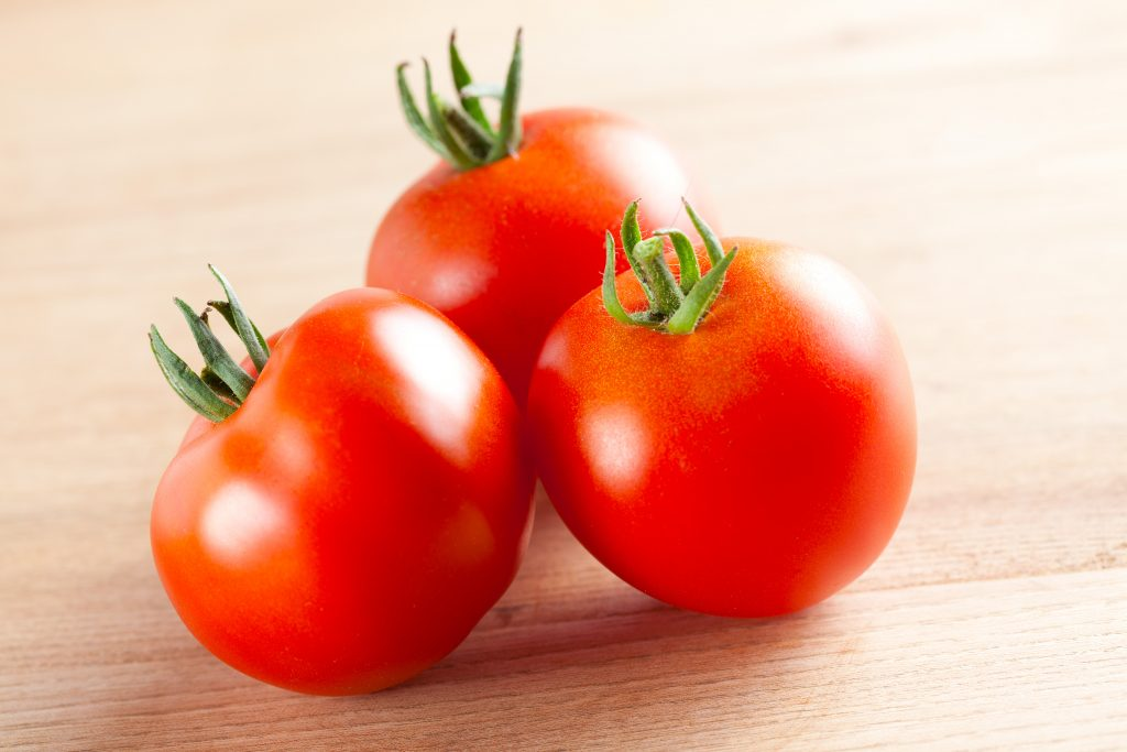 red tomatoes on table