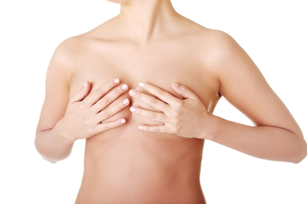 Breast cancer concept - Woman holding her breast