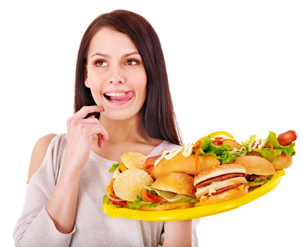 Thin woman holding group hamburger.