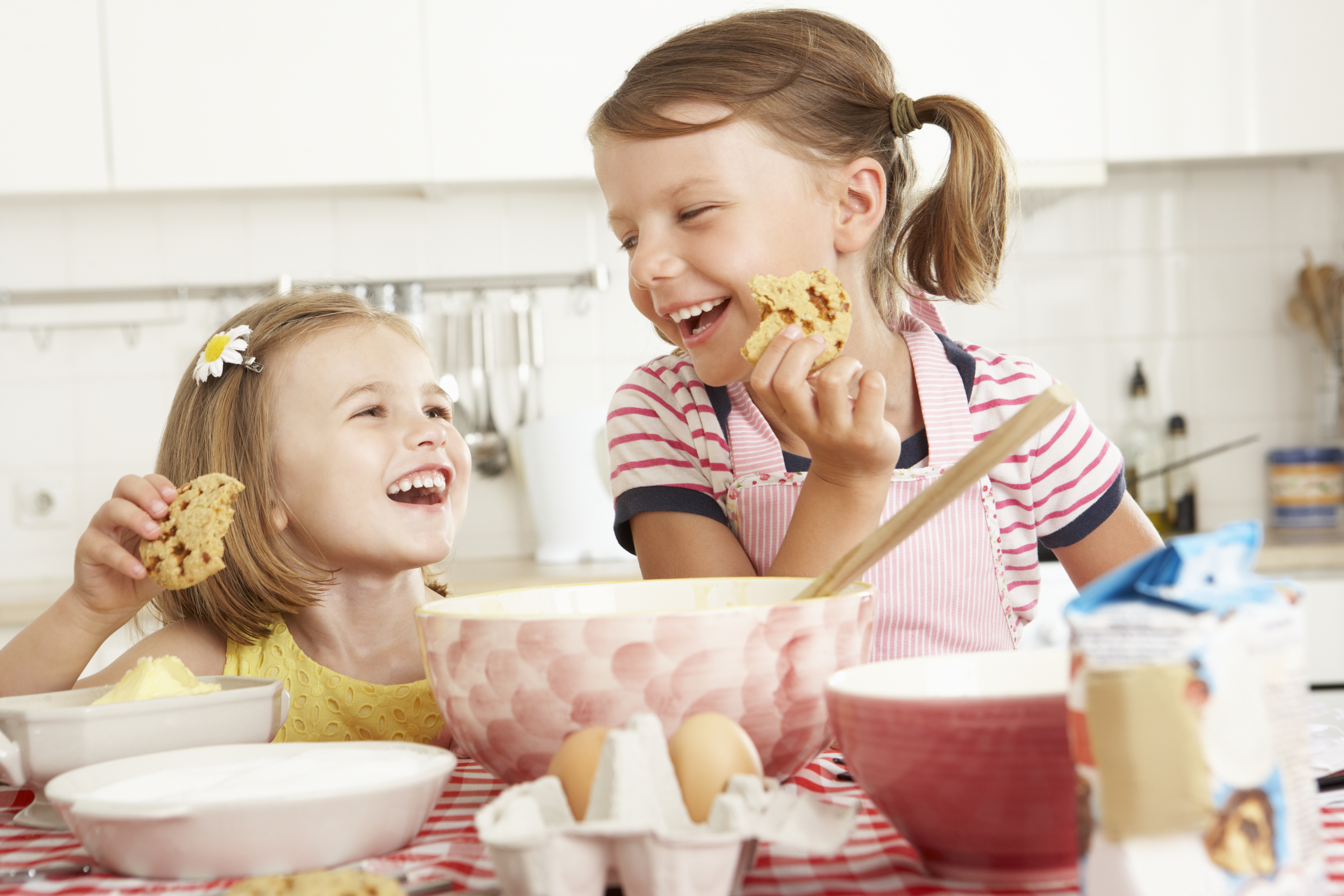 Two Girls Baking In Kitchen