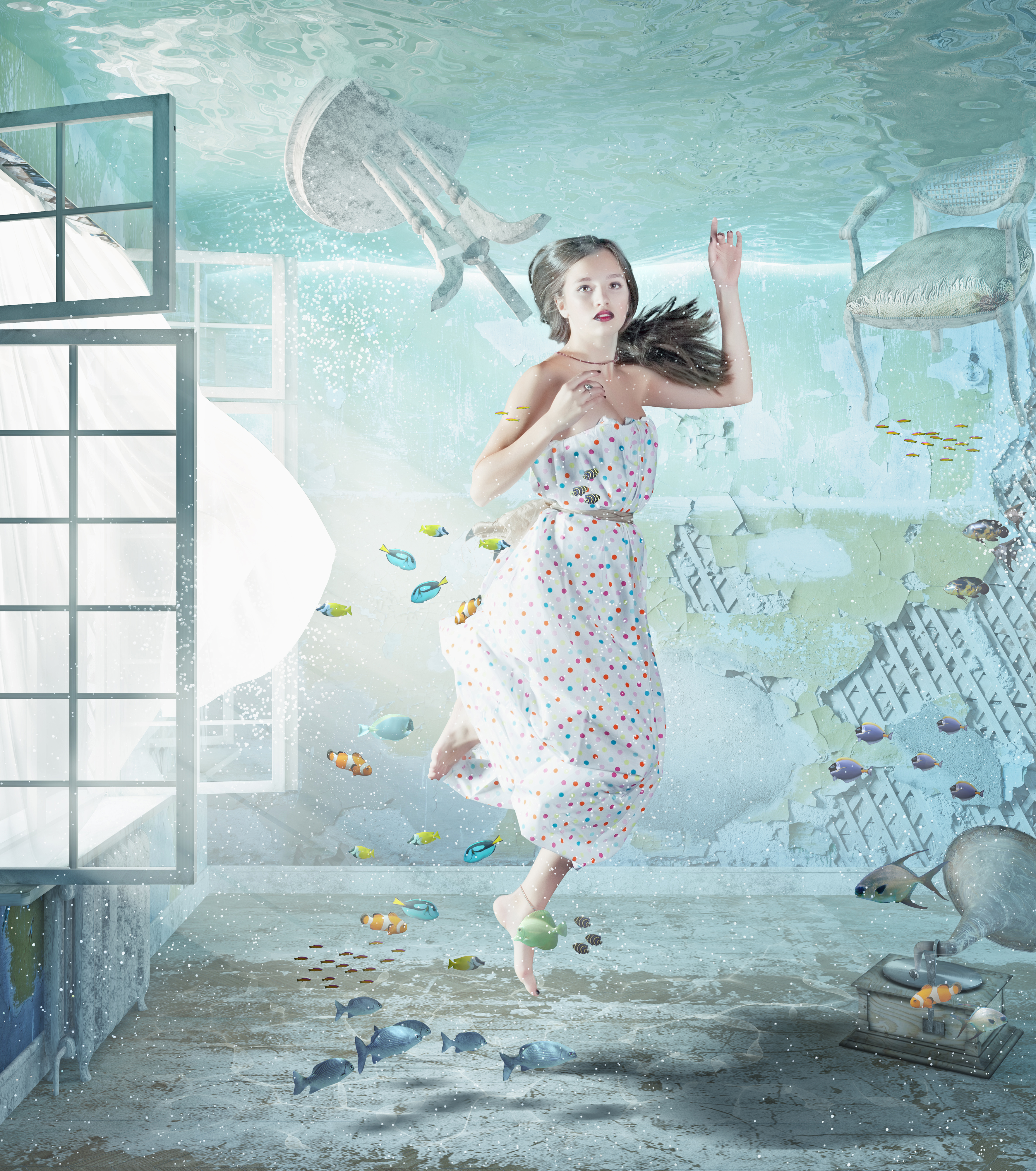the young beautiful girl underwater in the flooded interior. creative concept